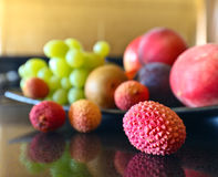 Tropical fruits on a kitchen table Royalty Free Stock Photography