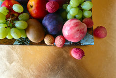 Tropical fruits on a kitchen table Royalty Free Stock Images