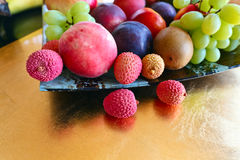 Tropical fruits on a kitchen table Royalty Free Stock Photo