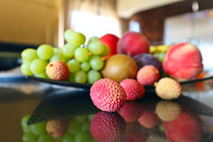 Tropical fruits on a kitchen table Stock Images