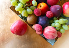 Tropical fruits on a kitchen table Stock Image