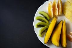 Tropical fruits, kiwi, mango, pineapple, orange and mandarin ora royalty free stock image