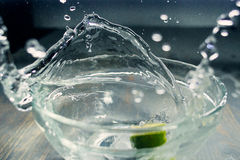 Tropical fruits Lime fall deeply under water with a big splash Royalty Free Stock Photos