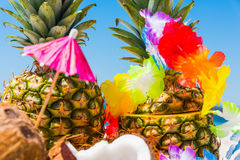 Tropical fruits and necklace on the beach Royalty Free Stock Photos