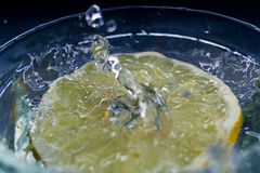 tropical fruits pamelo fall deeply under water with a big splash Stock Image