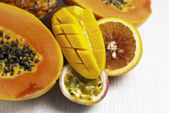Tropical fruits: papaya, pineapple, mango, passion fruit on white royalty free stock photo