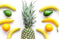 Tropical fruits pattern. Pineapple and bananas on white background top view Royalty Free Stock Photo