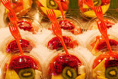 Tropical fruits in plastic trays Royalty Free Stock Photo