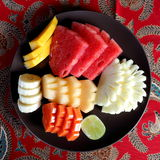 Tropical Fruits Platter. Slices of Variety of Tropical Fruits Being Served on Plate Royalty Free Stock Image