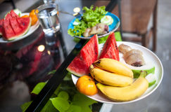 Tropical fruits and salad breakfast Stock Photo