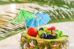 Tropical fruits salad in pineapple on sandy beach Royalty Free Stock Photos