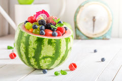 Tropical fruits salad in watermelon with berry fruits Royalty Free Stock Image