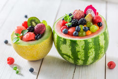 Tropical fruits salad in watermelon and melon Stock Images