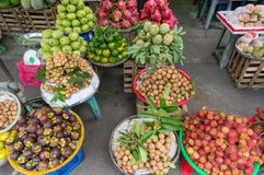 Tropical fruits on sale on street market stall royalty free stock image