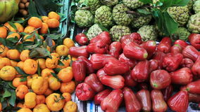 Tropical fruits for sale. In the Vietnamese market stock footage