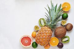Tropical fruits variety top view on white background stock photos