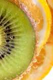 Tropical fruits in water, macro view Stock Photos