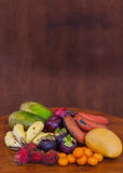 Tropical fruits on wooden table, close-up Stock Photography
