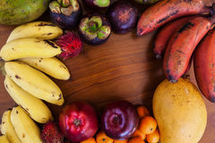 Tropical fruits on wooden table, top view Stock Image