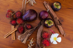 Tropical fruits on wooden table, top view. Fresh juicy tropical fruits on wooden table background, top view close-up Stock Photo