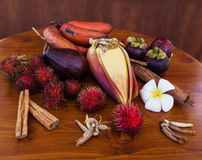 Tropical fruits on wooden table, top view. Fresh juicy tropical fruits on wooden table background, top view close-up Stock Photography