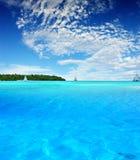 Tropical Fun. Boats sailing near tropical Island Royalty Free Stock Photography