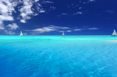 Tropical Fun. Boats sailing near tropical Motu Stock Photography