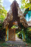 Tropical garden entrance with thatched roof Stock Photos