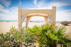 Tropical garden with gazebo on the beach. Stock Images