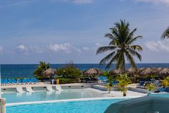 Tropical garden and pool overlooking the Caribbean sea as seen in Montego Bay Lucea Jamaica. West Indies royalty free stock image