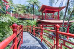Tropical Garden with red Japanese style pavilions in Funchal, Madeira Stock Photos