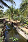 Tropical gardens in Vietnam. Landscaped tropical gardens of a resort hotel in Vietnam Royalty Free Stock Image