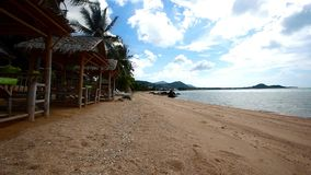 Tropical gazebo with chairs on amazing beach and stock video