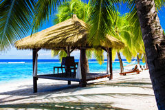 Tropical gazebo with chairs on a beach Royalty Free Stock Photos