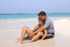Tropical getaway. A couple enjoying a beautiful tropical beach Stock Image