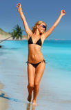 Tropical Girl. Beauty Girl in black swim suite royalty free stock photography
