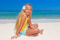 Tropical girl with frangipani flower Royalty Free Stock Image