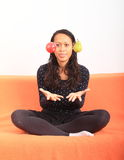Tropical girl juggling with apple and pear Royalty Free Stock Image