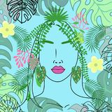 Tropical girl with leaves and flowers in her hair on a blue background.  Stock Photo