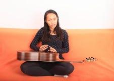 Tropical girl playing guitar Stock Photos