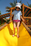 Tropical girl on slide Royalty Free Stock Image