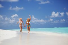 Tropical girls run Royalty Free Stock Photography