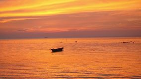 Tropical golden sunset with fishing ship. slow motion. 1920x1080. Tropical sunset with fishing ship stock footage
