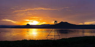 Tropical golden sunset on the Lake Taal, Luzon Island, Philippines. Horizon over the mountains and beautiful lake at sunset Royalty Free Stock Images