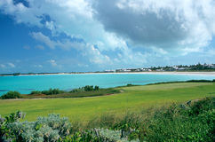 Tropical Golf Course. A golf course in the Bahamas overlooks a tropical beach resort Stock Photography
