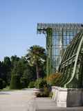 Tropical Greenhouse, Vienna, Schönbrunn, Palm. Entrance to 19th century greenhouse in Schönbrunn. With palmtrees and flowers. Architectural metal contruction Stock Photos