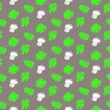 Tropical grunge pattern with fruits and leafs. Vector seamless ditsy pattern with hand drawn pineapples and silhouettes of monstera leaf plants in bright color Stock Images