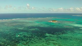 Tropical Guyam Island with a sandy beach and tourists. stock footage