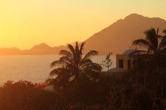 Tropical hacienda at sunset Stock Photo