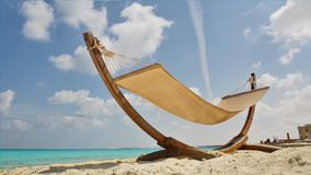 Tropical Hammock on Beach. An Empty Tropical Hammock on Beach under Sunlight stock footage